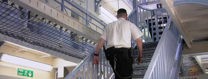 prison officer walking up stairs